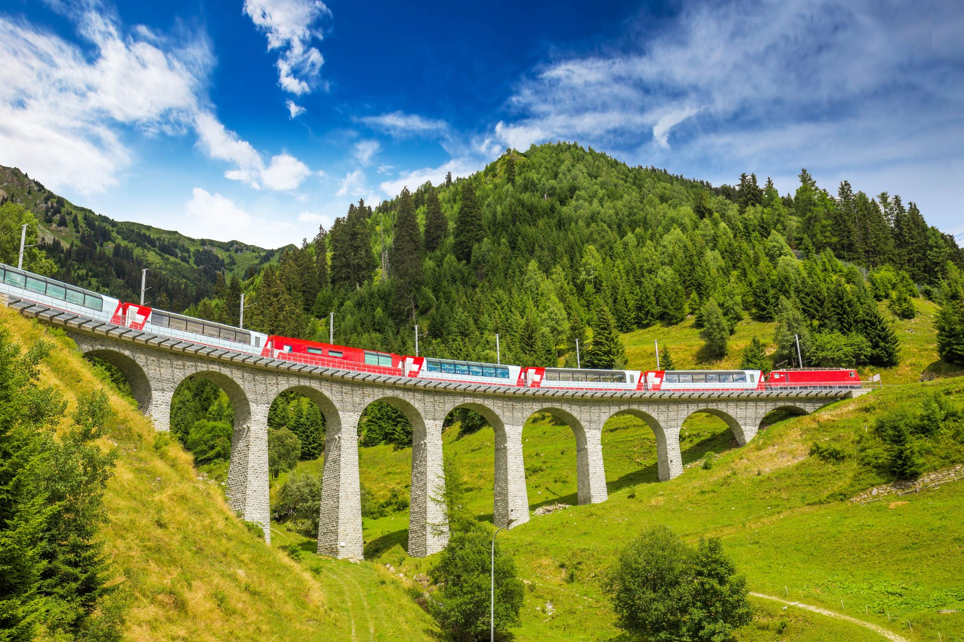 Train on famous landwasser Viaduct bridge. Photo: gevision/Bigstock.com